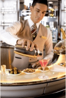 Emirates steward pouring drink