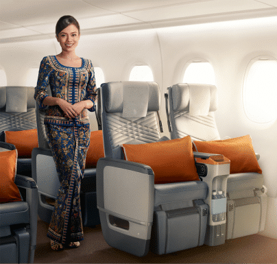Stewardess in Singapore Airline premium economy class
